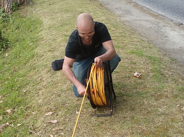 Niels Grobbe rolling the cables for electrical resistivity tomography